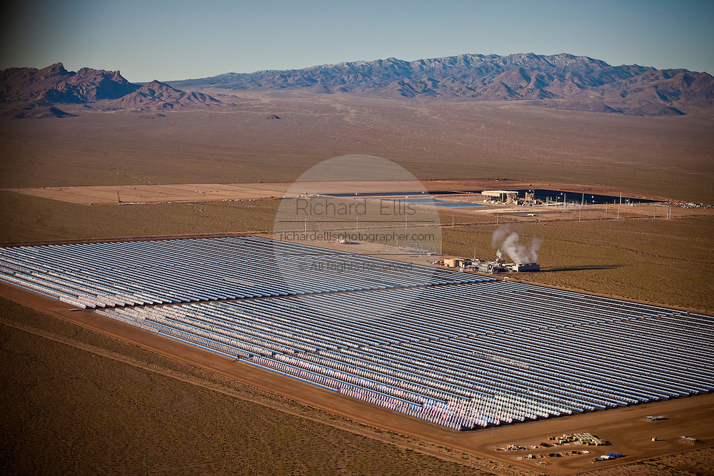 Aerial view of Nevada Solar One generating station, the largest concentrated solar power plant in the world using parabolic troughs in Boulder City, Nevada, USA. The plant has a maximum capacity of 75 MW.  Nevada Solar One uses 760 parabolic troughs (using more than 180,000 mirrors) made by Flabeg AG in Germany that concentrate the sun's rays onto thermos tubes placed at the focal axis of the troughs and containing a heat transfer fluid.