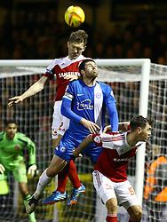 Peterborough United's Michael Bostwick gets beat in the air by Swindon Town's Darren Ward - Photo mandatory by-line: Joe Dent/JMP - Tel: Mobile: 07966 386802 11/01/2014 - SPORT - FOOTBALL - County Ground - Swindon - Swindon Town v Peterborough United - Sky Bet League One