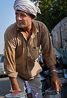 JAIPUR, INDIA - CIRCA NOVEMBER 2016: Man selling milk in the streets of  Jaipur.