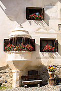 Oriel window in Engadine Valley village of Guarda with old painted stone 17th Century buildings, Switzerland