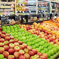 Apple varieties on display in a grocery shop