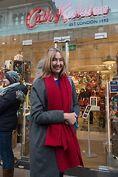 © Licensed to London News Pictures.05/12/2013. London, UK. Cath Kidston poses outside the store during the opening of the new Cath Kidston store at 180 Piccadilly, London. The new store is the largest Cath Kidston store in the world and  has over 20,000 products, including new ranges and services.Photo credit : Peter Kollanyi/LNP