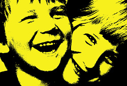 Portrait of young girl with arms around younger brother laughing,