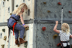 Peter and Autumn Phillips daughters Savannah (left) and Isla (right) on a climbing wall during the Royal Windsor Horse Show, which is held in the grounds of Windsor Castle in Berkshire.