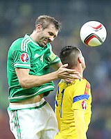 ROMANIA, Bucharest : Romania's Dragos Grigore (R) and Northern Ireland's Gareth McAuley (L) vie for the ball during the Euro 2016 Group F qualifying football match Romania vs Northern Ireland in Bucharest, Romania on November 14, 2014.