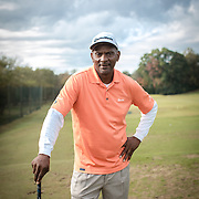 """CHARLOTTE, NC - OCTOBER, 28 2017:   James """"Slim"""" Bouler poses for a portrait on Dr. Charles Sifford Golf Course in west Charlotte, NC."""