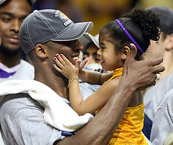 File photo dated june 14, 2009 of Los Angeles Lakers guard Kobe Bryant celebrates with his daughter following the Lakers' 99-86 defeat of the Orlando Magic in Game 5 of the NBA Finals at Amway Arena in Orlando on Sunday, June 14, 2009. (Stephen M. Dowell/Orlando Sentinel/TNS)