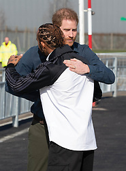Prince Harry, Duke of Sussex hugs six-time Formula One World Champion Lewis Hamilton during a visit to the Silverstone Circuit in Towcester, England to officially open The Silverstone Experience, a new immersive museum that tells the story of the past, present and future of British motor racing, on March 6, 2020.