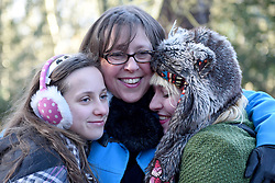 © Licensed to London News Pictures. 30/01/2016. Slough, UK. Sara Adams with daughters Daisy Adams, 12 and Caroline Adams, 23 at the formal opening of a wooden treehouse in memory of murder victim Alice Adams in Black Park, Wexham on Saturday 30th January. The 20-year-old was stabbed to death in August 2011 with her friend and co-worker Tibor Vass, at a staff flat behind the Radisson Edwardian Hotel near Heathrow Airport. The murderer was Attila Ban, aged 32,  who also worked at the hotel as a receptionist. After the death of Alice, her family created a charity called, Alice Adams Foundation, to raise money to build the treehouse. Photo credit should read: Emma Sheppard/LNP