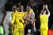 Liverpool striker Raheem Sterling and Liverpool striker Daniel Sturridge celebrate at the final whistle during the Capital One Cup match between Bournemouth and Liverpool at the Goldsands Stadium, Bournemouth, England on 17 December 2014.