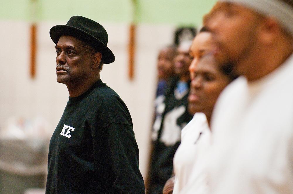 Matt Dixon   The Flint Journal..Justice Thigpen during a church league basketball game.