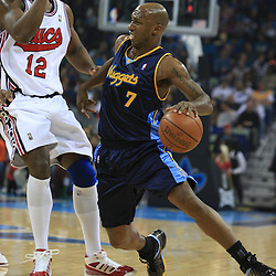 28 January 2009:  Denver Nuggets guard Chauncey Billups (7) drives past New Orleans Hornets center Hilton Armstrong (12) during a 94-81 win by the New Orleans Hornets over the Denver Nuggets at the New Orleans Arena in New Orleans, LA. The Hornets wore special throwback uniforms of the former ABA franchise the New Orleans Buccaneers for the game as they honored the Bucs franchise as a part of the NBA's Hardwood Classics series. .