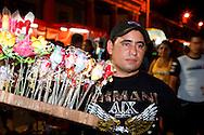 Selling faux flowers in Gibara, Holguin, Cuba.