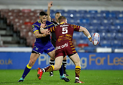 Huddersfield Giants Aaron Murphy offloads as he's tackled by Warrington's Declan Patton during the Betfred Super League match at the Kirklees Stadium, Huddersfield.