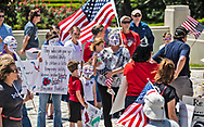 """People wearing Guy Fawkes masks at An 'End the Shutdown"""" protest in Baton Rouge. LA on April 25, 2020 in Baton Rouge , Louisiana. A group of a few dozen people who want the restrictions Gov. John Bel Edwards put in place to stop the spread of COVID-19 lifted, held a rally in front of the State Capitol Building on Saterday, before marching to the Governors Mansion where they called on him to end the shut down."""