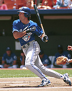 Toronto Blue Jay Paul Molitor hits a drive to center field against the Kansas City Royals at Kauffman Stadium in Kansas City, Missouri on June 11, 1995.