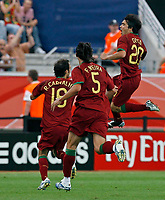 Photo: Glyn Thomas.<br />Portugal v Iran. Group D, FIFA World Cup 2006. 17/06/2006.<br /> Portugal's Deco (R) celebrates after scoring his side's first goal.