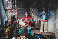 Addis Ababa, Ethiopia - July 31, 2010: A mother and children at the Merkato.