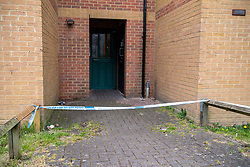 © Licensed to London News Pictures. 03/05/2021. Reading, UK. Police tape across a rear entrance to Belford Court on Luad Close following the death of a woman on Friday 30/04/2021. Thames Valley Police were called to an address on Laud Close, Reading at approximatly 16:30 BST after reports that a 34-year-old woman had died. The death was initially treated as unexplained while officers worked to establish the exact circumstances, but following a post mortem which took place on Sunday 02/05/2021 and gave the cause of death as a blunt force head injury, a murder investigation was formally launched. Photo credit: Peter Manning/LNP