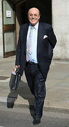 © London News Pictures. 14/08/2012. London, UK. Cypriot businessman Asil Nadir leaving The Old Bailey, in London on August 14, 2012 where the jury is currently considering a verdict  in the Polly Peck fraud case. Nadir, who fled to Cyprus in 1993 after the charges were first brought, is accused of £34m fraud at his firm Polly Peck. Photo credit : Ben Cawthra/LNP