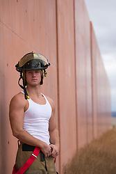 sexy muscular blond fireman outdoors