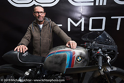 Marcus Walz of WalzWerk GmbH in his booth with BMW cafe racers at Motor Bike Expo. Verona, Italy. Thursday January 18, 2018. Photography ©2018 Michael Lichter.