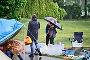 Nederland, the Netherlands, Nijmegen, 27-4-2019Koningsdag. Vrijmarkt in het Goffertpark. het was wisselend droog en regen, maar uiteindelijk zorgde een regenbui halverwege de middag ervoor dat de meeste mensen hun spullen pakten . Desondanks bleven de meeste mensen lachen...Foto: Flip Franssen