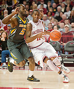 Feb 16, 2013; Fayetteville, AR, USA; Arkansas Razorbacks guard BJ Young (11) drives around Missouri Tigers guard Keion Bell (5) during a game at Bud Walton Arena. Arkansas defeated Missouri 73-71. Mandatory Credit: Beth Hall-USA TODAY Sports