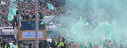 Hibernian Scottish Cup Open Top Bus Edinburgh 14 May 2016; The Hibs players show the trophy to the fans from bus as flares go off on Leith Walk during the open top bus parade in Edinburgh after winning the Scottish Cup.<br /> <br /> (c) Chris McCluskie | Edinburgh Elite media