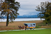 Tourist bus at Konigschloss Herrenchiemsee castle on Herren Insel island in Chiemsee Lake, Baden-Wurttenberg, Bavaria, Germany