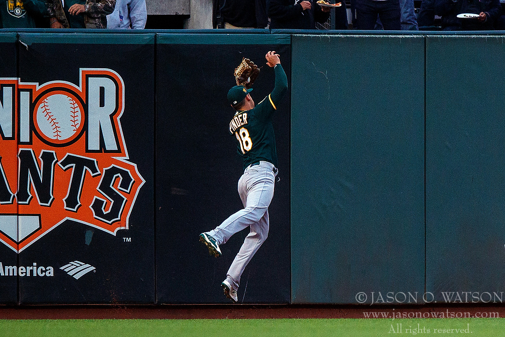 SAN FRANCISCO, CA - JULY 13: Chad Pinder #18 of the Oakland Athletics catches a fly ball hit off the bat of Madison Bumgarner (not pictured) of the San Francisco Giants during the third inning at AT&T Park on July 13, 2018 in San Francisco, California. The San Francisco Giants defeated the Oakland Athletics 7-1. (Photo by Jason O. Watson/Getty Images) *** Local Caption *** Chad Pinder