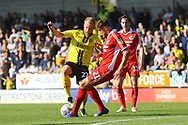 Scunthorpe United defender Cameron Burgess (21) tackles Burton Albion forward Liam Boyce (27) during the EFL Sky Bet League 1 match between Burton Albion and Scunthorpe United at the Pirelli Stadium, Burton upon Trent, England on 29 September 2018.