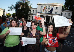 "© Licensed to London News Pictures . 18/07/2013 . London, UK. Spanish citizens living in London protest against Federico Trillo-Figueroa, the Spanish ambassador to Britain, outside the Spanish Embassy in Belgrave Square, London. <br /> They hold chorizos - spicy sausages- which mean ""thieves"" in Spanish slang and a replica of the papers published by the Spanish newspaper El Mundo, which accuse Mr Trillo-Figueroa for receiving €128,000 from a secret slush fund while serving as Defence Minister for the centre-right Popular Party (PP) Government of José Maria Aznar, former Prime Minister. The accusations were made by former treasurer of the Popular Party Luis Bárcenas, who is currently awaiting a trial on fraud charges.Photo credit : /LNP"