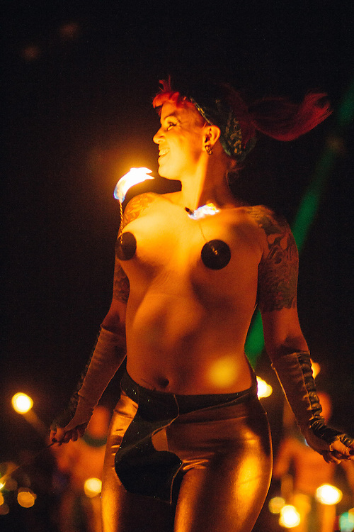 Rebecca Grace of Garnish, the Portland-based Fire Conclave, twirls flaming tasseled pasties.