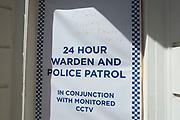 Defaced 24 hour police patrol poster as the Coronavirus lockdown continues, the city centre is still very quiet while more traffic and people are returning, and with restrictions due to be relaxed further in the coming days, the quiet city may be coming to an end as businesses are set to start to reopen soon on 27th May 2020 in Birmingham, England, United Kingdom. Coronavirus or Covid-19 is a respiratory illness that has not previously been seen in humans. While much or Europe has been placed into lockdown, the UK government has put in place more stringent rules as part of their long term strategy, and in particular social distancing.