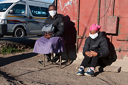 Two vendors wearing face masks at a taxi rank in Mayville, Durban, South Africa.