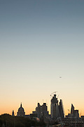 View of city skyline at sunrise from Waterloo Bridge, London, England, UK