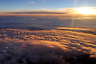 Flying into sunset above clouds.<br /> <br /> Larger JPEG + TIFF images available by contacting use through our contact page at :..www.photography4business.com
