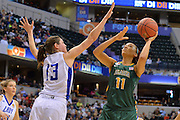 April 4, 2016; Indianapolis, Ind.; Megan Mullings puts up a shot over Kellyn Schneider in the NCAA Division II Women's Basketball National Championship game at Bankers Life Fieldhouse between UAA and Lubbock Christian. The Seawolves lost to the Lady Chaps 78-73.