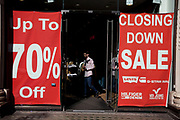 Closing Down Sale signs in the window of a clothing retail shop in central London, UK. Due to the economic downturn, many shops are closing.