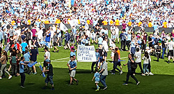 """Manchester City fans hold up a sign reading """"Football Aside Get Well Soon Fergie"""" in reference to former Manchester United manager Sir Alex Ferguson after the Premier League match at the Etihad Stadium, Manchester."""