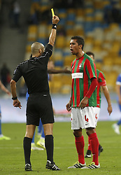 August 24, 2017 - Referee from Israel Liran Liany  makes a yellow card   Pablo Santos  of   Maritimo  during the  Europa League second play-off soccer match between FC Dynamo Kyiv and FC Maritimo, at the Olimpiyskyi stadium in Kyiv, Ukraine, August 24, 2017. (Credit Image: © Anatolii Stepanov via ZUMA Wire)