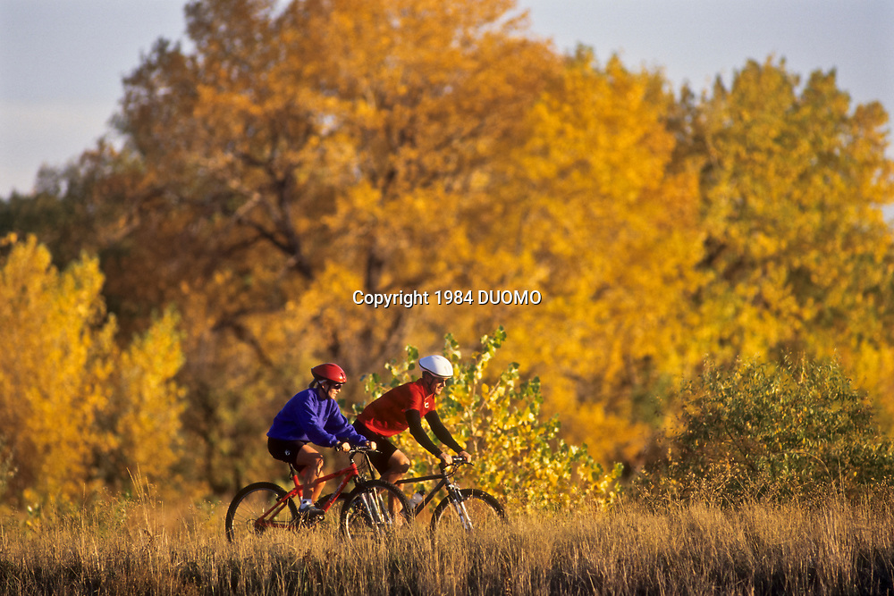 Couple mountain biking in Fall.