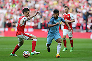 Sergio Aguero of Manchester city ® goes past Laurent Koscielny of Arsenal (l) .The Emirates FA Cup semi-final match, Arsenal v Manchester city at Wembley Stadium in London on Sunday 23rd April 2017.<br /> pic by Andrew Orchard,  Andrew Orchard sports photography.
