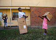 """Daja Jamison, right, 2, and her brother Donnie Jr. Jamison, 8, play with boxes that they will use to move to a different housing project outside their home at the Marina Vista Housing Project in Sacramento, Tuesday, August 13, 2019. The housing project failed its most recent health and safety inspection. They are moving to Oak Park to a higher rated housing project: """"I'm just grateful that I am moving, its been 7 years too long"""" said their mother, Marla Cooper."""