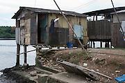 A house built over the water at vila dos pescadores favela, Cubatão
