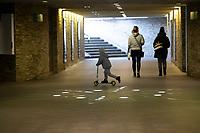 Bialystok, 20.03.2020. Wyludnione ulice Bialegostku podczas epidemii koronawirusa N/z wyludnione przejscie podziemne przy zbiegu ulicy Sienkiewicza i Alei Pilsudskiego; dziecko na hulajnodze fot Michal Kosc / AGENCJA WSCHOD