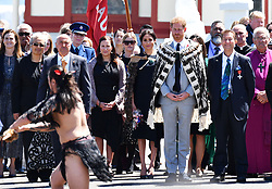 The Duke and Duchess of Sussex wear traditional Maori cloaks called Korowai as they watch a welcome ceremony during a visit to Te Papaiouru, Ohinemutu, in Rotorua, before a lunch in honour of Harry and Meghan, on day four of the royal couple's tour of New Zealand.