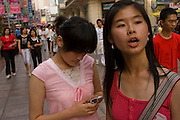 Chen Zhen (right) a law student with her friend on Nanjing East Road in Shanghai China. (She is featured in the book What I Eat: Around the World in 80 Diets). The caloric value of her typical day's worth of food in June was 2600 kcals. She is 20 years of age; 5 feet, 5 inches tall and 106 pounds.  Chen Zhen eats at KFC 3 times a week and what she eats depends on the coupons that she and her friends gather to defray the cost of the meal. The rest of her meals in the course of a week are largely Chinese and traditional. She eats simple fare at her university campus cafeteria--soups with rice and vegetables. Her grandparents and father go without meat throughout the week so they can serve it to her on the weekends when she's home from school. MODEL RELEASED