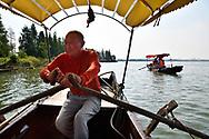Oarsman, earlier fisherman, East Lake Greenway park, Wuhan, Hubei, China